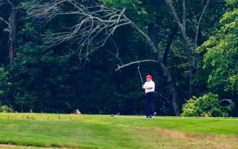 epa08512912 US President Donald J. Trump plays golf at the Trump National Golf Club in Sterling, Virginia, USA, 27 June 2020. On 26 June, Trump abruptly canceled a weekend trip to Bedminster, NJ, tweeting that he 'wanted to stay in Washington, D.C. to make sure LAW & ORDER is enforced.'  EPA/JIM LO SCALZO