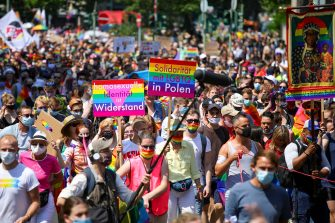 epa08511622 People take part in the 'Pride Berlin' demonstration in Berlin, Germany, 27 June  2020. A large crowd marched under the motto 'Save our Community, Save our Pride' in solidarity with the hardships of the German capital's LGBTIQ community but also in Poland, Russia, Ukraine. Berlin's world famous pride parade, Christopher Street Day (CSD) which was scheduled to take place end of July was cancelled this year due to the Coronavirus pandemic.  EPA/OMER MESSINGER