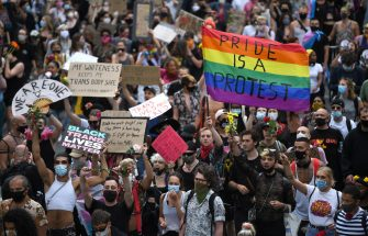 epa08512800 Protesters march as part of a Black Trans Lives Matter demonstration in what would have been the LGBT+ Pride march in London, Britain, 27 June 2020. Protesters gathered to demonstrate for black LGBT+ rights as part of the Black Lives Matter movement, which as been re-ignited following the death of 46-year-old African-American George Floyd while in police custody in the US. The traditional Pride match to celebrate LGBT+ rights was canceled due to the ongoing pandemic of the COVID-19 disease caused by the SARS-CoV-2 coronavirus.  EPA/NEIL HALL