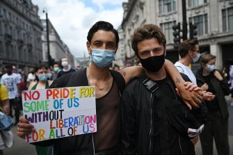 epa08512161 People take part in a reduced Pride during a reduced Pride March in London, Britain, 27 June 2020. Former members of London's Gay Liberation Front are marking the organization's 50th birthday by marching the route of cancelled pride parade. The GLF protest also supports Black Lives Matter movement and the LGBTQ+ people.  EPA/NEIL HALL