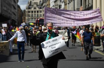 epa08512168 Peter Tatchell of the Gay Liberation Front holds a banner during a protest of former members of GLF in London, Britain, 27 June 2020. Former members of London's Gay Liberation Front are marking the organization's 50th birthday by marching the route of cancelled pride parade. The protest also supports Black Lives Matter movement and the LGBTQ+ people.  EPA/NEIL HALL