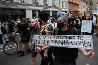 epa08512807 Protesters march as part of a Black Trans Lives Matter demonstration in what would have been the LGBT+ Pride march in London, Britain, 27 June 2020. Protesters gathered to demonstrate for black LGBT+ rights as part of the Black Lives Matter movement, which as been re-ignited following the death of 46-year-old African-American George Floyd while in police custody in the US. The traditional Pride match to celebrate LGBT+ rights was canceled due to the ongoing pandemic of the COVID-19 disease caused by the SARS-CoV-2 coronavirus.  EPA/NEIL HALL