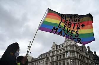 epa08512793 Protesters march as part of a Black Trans Lives Matter demonstration in what would have been the LGBT+ Pride march in London, Britain, 27 June 2020. Protesters gathered to demonstrate for black LGBT+ rights as part of the Black Lives Matter movement, which as been re-ignited following the death of 46-year-old African-American George Floyd while in police custody in the US. The traditional Pride match to celebrate LGBT+ rights was canceled due to the ongoing pandemic of the COVID-19 disease caused by the SARS-CoV-2 coronavirus.  EPA/NEIL HALL