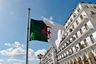 The Algerian flag is seen at half mast in the capital Algiers on April 12, 2018 after  the president declared three days of national mourning over a military plane crash in which 257 people were killed. - Algeria suffered its deadliest ever air catastrophe the previous day when a military plane crashed after takeoff, killing 257 people on board, mostly army personnel and their family members. (Photo by RYAD KRAMDI / AFP)        (Photo credit should read RYAD KRAMDI/AFP via Getty Images)