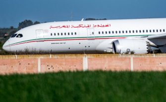 "This picture taken on February 2, 2020 shows a Royal Air Maroc (RAM) Boeing 787-8 ""Dreamliner"" aircraft landing at Morocco's Benslimane airport, reportedly carrying repatriated Moroccan citizens from China's Wuhan province following the outbreak of the SARS-like ""Wuhan coronavirus"" (novel coronavirus 2019-nCoV). (Photo by FADEL SENNA / AFP) (Photo by FADEL SENNA/AFP via Getty Images)"