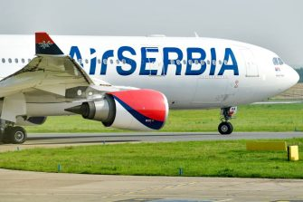 A picture taken on June 23, 2016 shows an Airbus A330-202 air-plane of the Serbian national carrier Air Serbia before taking off at the Belgrade Airport, for the first commercial flight to New York after a 24-year interruption caused by the conflicts that ravaged the former Yugoslavia. - Air Serbia, which is the only regional airline offering direct flights to the United States, will fly to New York JFK airport five times a week. Preparations for the reintroduction of this line lasted a year. According to an official of the Serbian company, 15,000 tickets have already been sold. In 1992, JAT company, Air Serbia predecessor, stopped its direct flights to the United States after the introduction of international sanctions against Yugoslavia (Serbia and Montenegro) because of the bloody conflict in the region. (Photo by ANDREJ ISAKOVIC / AFP)        (Photo credit should read ANDREJ ISAKOVIC/AFP via Getty Images)