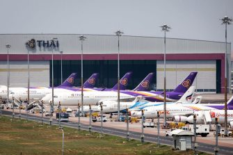 Thai Airways aircraft are parked on the tarmac at Suvarnabhumi Airport in Bangkok on March 25, 2020 as the airline suspended international flights due to the COVID-19 coronavirus. (Photo by Jack TAYLOR / AFP) (Photo by JACK TAYLOR/AFP via Getty Images)