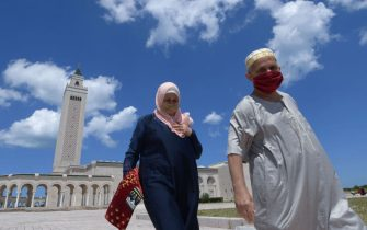 Tunisians wearing protective masks leave after attending the first Friday prayer following a 3-months suspension due to the novel coronavirus, at the Malek Ibn Anas Mosque in Carthage near the capital Tunis, on June 5, 2020. (Photo by FETHI BELAID / AFP) (Photo by FETHI BELAID/AFP via Getty Images)