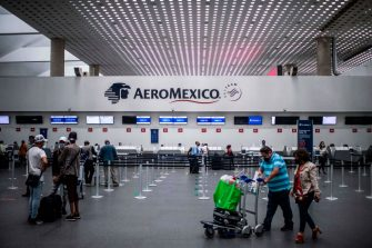 Passengers wait at the counters of Aeromexico, at Mexico City's International Airport, on June 19, 2020, amid the new coronavirus pandemic. - Aeromexico, Mexico's largest airline, informed the Mexican Stock Exchange on Friday it has not used the U.S. bankruptcy law, nor has it decided to do so, following press reports announcing it was close to starting the process, overwhelmed by the COVID-19 pandemic. (Photo by PEDRO PARDO / AFP) (Photo by PEDRO PARDO/AFP via Getty Images)