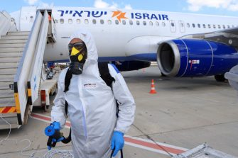 TEL AVIV, ISRAEL - MAY 25: Yair Badash, a maintenance manager at the Israeli low-cost ariline Israir, wears his PPE as he prepares to disinfect an aircraft between flights at Ben Gurion Airport on May 25, 2020 near Tel Aviv, Israel. Israir uses a Boeing and Airbus approved chemical fog that is sprayed on all inner surfaces before the plane is sealed for 45 minutes to disinfect the aircraft from any traces of the Covid-19 corona-virus. (Photo by David Silverman/Getty Images)
