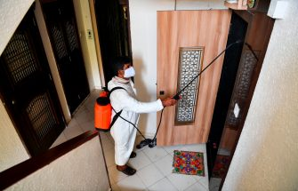 A municipal worker sprays disinfectant in a residential area during a government-imposed nationwide lockdown as a preventive measure against the spread of the COVID-19 coronavirus in Mumbai on March 30, 2020. (Photo by Indranil MUKHERJEE / AFP) (Photo by INDRANIL MUKHERJEE/AFP via Getty Images)