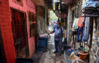 A municipal worker sprays disinfectant in an alley where a patient had tested positive for the virus during a government-imposed nationwide lockdown as a preventive measure against the COVID-19 coronavirus, in Mumbai on March 31, 2020. (Photo by INDRANIL MUKHERJEE / AFP) (Photo by INDRANIL MUKHERJEE/AFP via Getty Images)