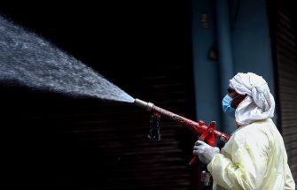A municipal worker sprays disinfectant solution to sanitise a residential area during a government-imposed nationwide lockdown as a preventive measure against the spread of the COVID-19 coronavirus in Faridabad on April 15, 2020. (Photo by Money SHARMA / AFP) (Photo by MONEY SHARMA/AFP via Getty Images)