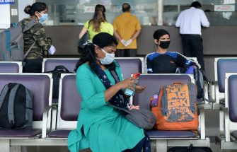 A passenger sprays disinfectant on her hand as she waits to board her flight at the Kamaraj domestic airport during the first day of resuming of domestic flights after the government imposed a nationwide lockdown as a preventive measure against the spread of the COVID-19 coronavirus, in Chennai on May 25, 2020. - Confusion and concern reigned at Indian airports on May 25 as domestic flights tentatively resumed after two months, even as coronavirus cases continued to surge at record rates. (Photo by Arun SANKAR / AFP) (Photo by ARUN SANKAR/AFP via Getty Images)