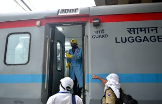 A railway worker sprays disinfectant to sanitise a train carriage arrived from Mumbai after the government eased a nationwide lockdown imposed as a preventive measure against the COVID-19 coronavirus, at the railway station in Allahabad on May 30, 2020. (Photo by SANJAY KANOJIA / AFP) (Photo by SANJAY KANOJIA/AFP via Getty Images)