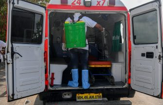 In this photograph taken on May 24, 2020, an employee sprays disinfectant inside a HelpNow ambulance, after the government eased a nationwide lockdown imposed as a preventive measure against the COVID-19 coronavirus, in Mumbai. - As coronavirus hotspot Mumbai grapples with crippling healthcare shortages, an ambulance service founded by three students is trying to fill the gap in India's worst-hit city. But many patients are too poor to pay for the life-saving trip. (Photo by INDRANIL MUKHERJEE / AFP) / To go with 'INDIA-HEALTH-VIRUS-AMBULANCE-POVERTY' by Ammu Kannampilly (Photo by INDRANIL MUKHERJEE/AFP via Getty Images)