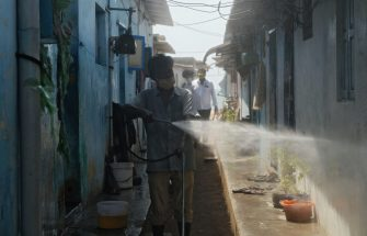 A health worker sprays disinfectant at containment low-income residential area after a rise of COVID-19 infection cases during a lockdown as a preventive measure against the COVID-19 coronavirus in Chennai on June 24, 2020. - A lockdown was reimposed on 15 million people in southern India on June 19 as the number of coronavirus infections in the hard-hit nation neared 400,000. New restrictions in Chennai, the capital of Tamil Nadu state, and surrounding districts followed a surge of cases, even as the rest of the country of 1.3 billion people gradually resumes normal life. (Photo by Arun SANKAR / AFP) (Photo by ARUN SANKAR/AFP via Getty Images)