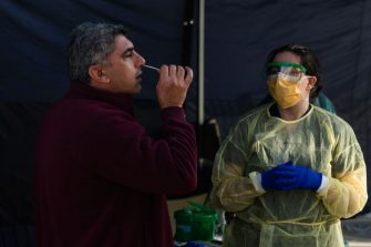 MELBOURNE, AUSTRALIA - JUNE 28: A man places as swab in his nose as he is tested at a pop-up testing facility, during a COVID-19 testing blitz in the suburb of Broadmeadows on June 28, 2020 in Melbourne, Australia. Victoria's confirmed COVID-19 infection numbers continue to rise, with 49 new coronavirus cases recorded overnight. Health authorities are continuing on a testing blitz in Melbourne suburbs that have been identified as community transmission hotspots for coronavirus. Restrictions in Victoria have been tightened in response to the spike in new cases across the state with premier Daniel Andrews extending the current state of emergency for at least four weeks to allow police the power to enforce social distancing rules. (Photo by Asanka Ratnayake/Getty Images)