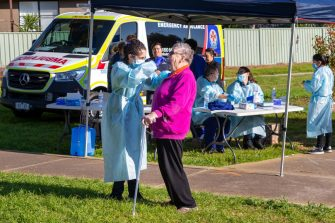 MELBOURNE, AUSTRALIA - JUNE 28: An elderly woman is tested at a pop-up clinic during a COVID-19 testing blitz in the suburb of Broadmeadows on June 28, 2020 in Melbourne, Australia. Victoria's confirmed COVID-19 infection numbers continue to rise, with 49 new coronavirus cases recorded overnight. Health authorities are continuing on a testing blitz in Melbourne suburbs that have been identified as community transmission hotspots for coronavirus. Restrictions in Victoria have been tightened in response to the spike in new cases across the state with premier Daniel Andrews extending the current state of emergency for at least four weeks to allow police the power to enforce social distancing rules. (Photo by Asanka Ratnayake/Getty Images)