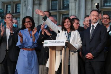 Current Mayor of Paris and candidate in the forthcoming 2020 mayoral elections for the socialist Party (PS) Anne Hidalgo (C) waves as she delivers a speech at the Hotel de Ville in Paris after she won the 2020 mayoral elections on June 28, 2020. (Photo by JOEL SAGET / AFP) (Photo by JOEL SAGET/AFP via Getty Images)