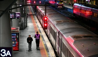 A man runs for his train during rush hour at Melbourne's Southern Cross station on June 30, 2020. - Hundreds of thousands of people across Melbourne's north and west were ordered to stay at home on June 30 as Australia's second-biggest city struggled to contain a spike in coronavirus cases. (Photo by William WEST / AFP) (Photo by WILLIAM WEST/AFP via Getty Images)