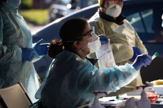 MELBOURNE, AUSTRALIA - JUNE 28: A member of the Covid-19 DHS testing team holds a vile with a swab from a test conducted at a pop-up testing facility during a COVID-19 testing blitz in the suburb of Broadmeadows on June 28, 2020 in Melbourne, Australia. Victoria's confirmed COVID-19 infection numbers continue to rise, with 49 new coronavirus cases recorded overnight. Health authorities are continuing on a testing blitz in Melbourne suburbs that have been identified as community transmission hotspots for coronavirus. Restrictions in Victoria have been tightened in response to the spike in new cases across the state with premier Daniel Andrews extending the current state of emergency for at least four weeks to allow police the power to enforce social distancing rules. (Photo by Asanka Ratnayake/Getty Images)