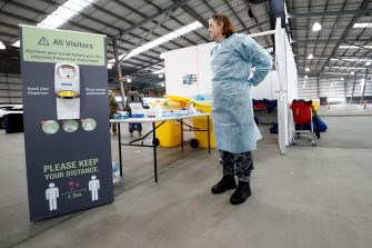 MELBOURNE, AUSTRALIA - JUNE 29:  ADF (Australian Defence Force) personnel assist with a COVID-19 testing at Melbourne Showgrounds on June 29, 2020 in Melbourne, Australia. Victoria has recorded 75 new coronavirus cases overnight, the state's fourth-highest single day rise since the start of the pandemic, while increased testing in Melbourne suburbs that have been identified as community transmission hotspots for coronavirus continues. Restrictions in Victoria have been tightened in response to the spike in new cases across the state with premier Daniel Andrews extending the current state of emergency for at least four weeks to allow police the power to enforce social distancing rules. (Photo by Darrian Traynor/Getty Images)