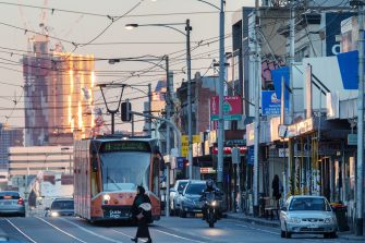 MELBOURNE, AUSTRALIA - JUNE 29: A tram headed for Coburg is seen on Sydney Road in Brunswick which is in the council of Moreland in Melbourne on June 29, 2020 in Melbourne, Australia. Victoria has recorded 75 new coronavirus cases overnight, the state's fourth-highest single day rise since the start of the pandemic, while increased testing in Melbourne suburbs that have been identified as community transmission hotspots for coronavirus continues. Restrictions in Victoria have been tightened in response to the spike in new cases across the state with premier Daniel Andrews extending the current state of emergency for at least four weeks to allow police the power to enforce social distancing rules. (Photo by Darrian Traynor/Getty Images)