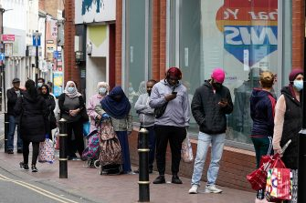 LEICESTER, ENGLAND - JUNE 30: People queue outside a bank in Leicester City Centre before non-essential shops close for the localised pandemic lockdown on June 30, 2020 in Leicester, England. As the rest of England prepares to reopen pubs and restaurants this weekend, Leicester is closing all non-essential businesses again after a spike in coronavirus cases worried officials. (Photo by Christopher Furlong/Getty Images)