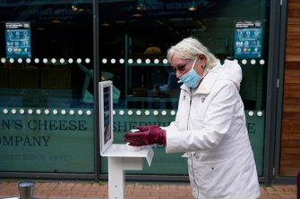 LEICESTER, ENGLAND - JUNE 30: People use a hand sanitation station as they enter Leicester market  before non-essential shops close for the localised pandemic lockdown on June 30, 2020 in Leicester, England. As the rest of England prepares to reopen pubs and restaurants this weekend, Leicester is closing all non-essential businesses again after a spike in coronavirus cases worried officials. (Photo by Christopher Furlong/Getty Images)