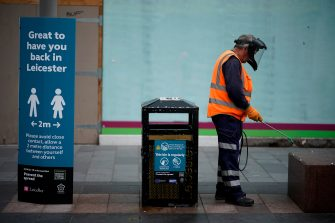 LEICESTER, ENGLAND - JUNE 30: A council worker disinfects street furniture in Leicester City Centre before non-essential shops close for the localised pandemic lockdown on June 30, 2020 in Leicester, England. As the rest of England prepares to reopen pubs and restaurants this weekend, Leicester is closing all non-essential businesses again after a spike in coronavirus cases worried officials. (Photo by Christopher Furlong/Getty Images)