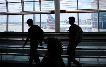 CHARLOTTE,NC  - MAY 15: Passengers walk between terminals at Charlotte Douglas International Airport on May 15, 2020 in Charlotte, North Carolina. Air travel is down an estimated 94 percent due to the coronavirus (COVID-19) pandemic and major U.S. airlines are taking a major financial hit with losses of $350 million to $400 million a day and nearly half of major carriers airplanes are sitting idle.   (Photo by Chris Graythen/Getty Images)