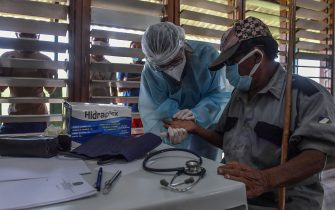 Members of the Brazilian Armed Forces medical team take a COVID-19 test from a member of the indigenous Ye'Kuena ethnic group, at the 5th Special Frontier Platoon in Auari, Roraima state, Brazil, on June 30, 2020, amid the novel coronavirus COVID-19 pandemic. (Photo by NELSON ALMEIDA / AFP) (Photo by NELSON ALMEIDA/AFP via Getty Images)