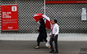 LEICESTER, ENGLAND - JULY 01: People walk past a closed Argos store during lockdown on July 01, 2020 in Leicester, England. Ten per cent of all the recent UKs Covid-19 deaths occurred in Leicester, which became the first British city to be put into regional lockdown on Tuesday night. (Photo by Darren Staples/Getty Images)