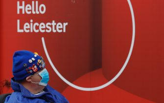 LEICESTER, ENGLAND - JULY 01: A man passes a closed vodafone shop on July 01, 2020 in Leicester, England. Ten per cent of all the recent UKs Covid-19 deaths occurred in Leicester, which became the first British city to be put into regional lockdown on Tuesday night. (Photo by Darren Staples/Getty Images)