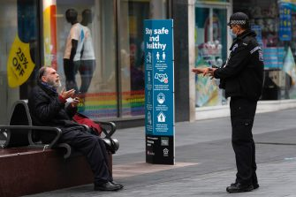 LEICESTER, ENGLAND - JULY 01: A police officer talks to a man sitting on a bench during lockdown on July 01, 2020 in Leicester, England. Ten per cent of all the recent UKs Covid-19 deaths occurred in Leicester, which became the first British city to be put into regional lockdown on Tuesday night. (Photo by Darren Staples/Getty Images)