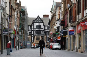 LEICESTER, ENGLAND - JULY 01: A man walks down a near empty shopping street during lockdown on July 01, 2020 in Leicester, England. Ten per cent of all the recent UKs Covid-19 deaths occurred in Leicester, which became the first British city to be put into regional lockdown on Tuesday night. (Photo by Darren Staples/Getty Images)