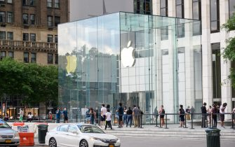 NEW YORK, NEW YORK - JUNE 30: People stand in line outside the Apple store on Fifth Avenue as New York City moves into Phase 2 of re-opening following restrictions imposed to curb the coronavirus pandemic on June 30, 2020. Phase 2 permits the reopening of offices, in-store retail, outdoor dining, barbers and beauty parlors and numerous other businesses. Phase 2 is the second of four phased stages designated by the state. (Photo by Noam Galai/Getty Images)