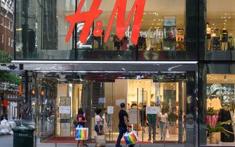 NEW YORK, NEW YORK - JUNE 30: People walk outside the H&M store on Fifth Avenue as New York City moves into Phase 2 of re-opening following restrictions imposed to curb the coronavirus pandemic on June 30, 2020. Phase 2 permits the reopening of offices, in-store retail, outdoor dining, barbers and beauty parlors and numerous other businesses. Phase 2 is the second of four phased stages designated by the state. (Photo by Noam Galai/Getty Images)
