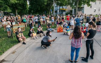 MINNEAPOLIS, MN - JUNE 30: Demonstrators listen during the Cancel Rent and Mortgages rally on June 30, 2020 in Minneapolis, Minnesota. The rally was organized to demand the temporary cancellation of rents and mortgages as COVID-19 continues to adversely effect the economy. (Photo by Brandon Bell/Getty Images)