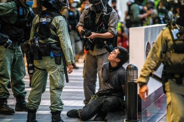 A protester (centre R) is detained by police during a rally against a new national security law in Hong Kong on July 1, 2020, on the 23rd anniversary of the city's handover from Britain to China. - Hong Kong police arrested more than 300 people on July 1 -- including nine under China's new national security law -- as thousands defied a ban on protests on the anniversary of the city's handover to China. (Photo by Anthony WALLACE / AFP) (Photo by ANTHONY WALLACE/AFP via Getty Images)