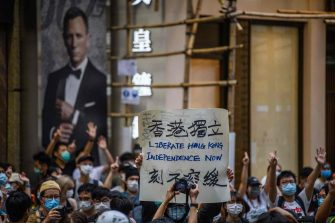 Protesters chant slogans and hold a placard during a rally against a new national security law in Hong Kong on July 1, 2020, on the 23rd anniversary of the city's handover from Britain to China. - Hong Kong police arrested more than 300 people on July 1 -- including nine under China's new national security law -- as thousands defied a ban on protests on the anniversary of the city's handover to China. (Photo by Anthony WALLACE / AFP) (Photo by ANTHONY WALLACE/AFP via Getty Images)