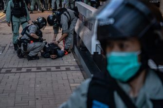 HONG KONG, CHINA - JULY 01: A man is being arrested by riot police during a demonstration against the new national security law on July 1, 2020 in Hong Kong, China. Hong Kong marks the 23rd anniversary of its handover to China on July 1 after Beijing imposed the new national security law. (Photo by Anthony Kwan/Getty Images)