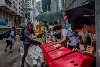 HONG KONG, CHINA - JULY 01: Pro-democracy protesters set up barricades during a rally against a new national security law, on the 23rd anniversary of the city's handover from Britain to China on July 1, 2020 in Hong Kong, China. (Photo by Billy H.C. Kwok/Getty Images)