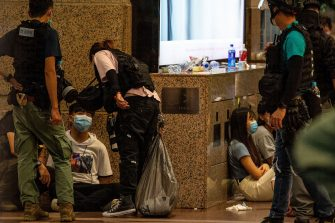 Police detain people after they cleared protesters taking part in a rally against a new national security law in Hong Kong on July 1, 2020, on the 23rd anniversary of the city's handover from Britain to China. - Hong Kong police arrested more than 300 people on July 1 -- including nine under China's new national security law -- as thousands defied a ban on protests on the anniversary of the city's handover to China. (Photo by Alastair Pike / AFP) (Photo by ALASTAIR PIKE/AFP via Getty Images)