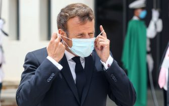 French President Emmanuel Macron puts on a face mask after arriving at Nouakchott--Oumtounsy International Airport on June 30, 2020, in Nouakchott, to attend a G5 Sahel summit. - The leaders of the G5 Sahel West African countries and their ally France are meeting to confer over their troubled efforts to stem a jihadist offensive unfolding in the region, six months after rebooting their campaign in Pau, southwestern France. (Photo by Ludovic MARIN / POOL / AFP) (Photo by LUDOVIC MARIN/POOL/AFP via Getty Images)