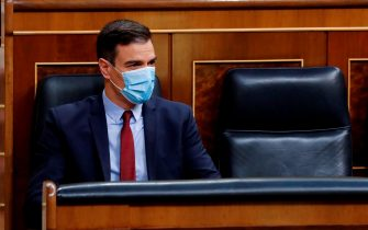 Spanish Prime Minister, Pedro Sanchez wears a face mask during a parliamentary plenary session at the Lower Chamber of Spanish Parliament, in Madrid, on May 20, 2020. - Renewed four times, the state of emergency has let the government impose some of the world's tightest restrictions on Spain's nearly 47 million population, although it has since begun a cautious rollback which is due to finish by late June. (Photo by Andres BALLESTEROS / POOL / AFP) (Photo by ANDRES BALLESTEROS/POOL/AFP via Getty Images)