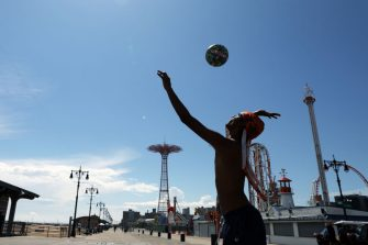 NEW YORK, NEW YORK - JULY 01: A teenager enjoys an afternoon at the beach at Brooklyn's Coney Island on the first day that swimming is allowed at New York City beaches on July 01, 2020 in New York City. Area beaches had been closed to swimming due to concerns of crowding at beaches and the risk of spread of the coronavirus. (Photo by Spencer Platt/Getty Images)