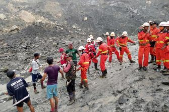epa08522223 A handout photo made available by the Myanmar Fire Services Department shows rescue workers searching for people after a landslide accident at a jade mining site in Hpakant, Kachin State, Myanmar, 02 July 2020. According media reports, search and rescue efforts are ongoing after a landslide was triggered by heavy rain in the area.  EPA/Myanmar Fire Services Department HANDOUT  HANDOUT EDITORIAL USE ONLY/NO SALES