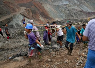 epa08522659 Volunteers carry the body of a victim after a landslide at a jade mining site in Hpakant, Kachin State, Myanmar, 02 July 2020. According to media reports, search and rescue efforts are ongoing after a landslide at a jade mining site was triggered by heavy rain. At least 126 bodies have been found, media added.  EPA/ZAW MOE HTET